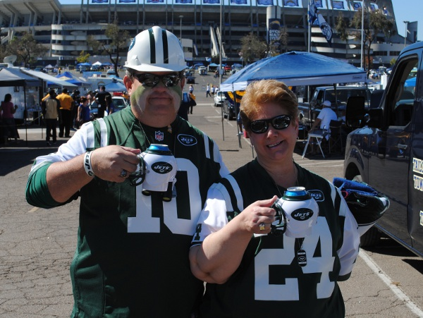 New York Jets fans holding their NY Jets FanMugs