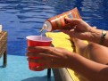 Sunscreen Flask pouring by pool