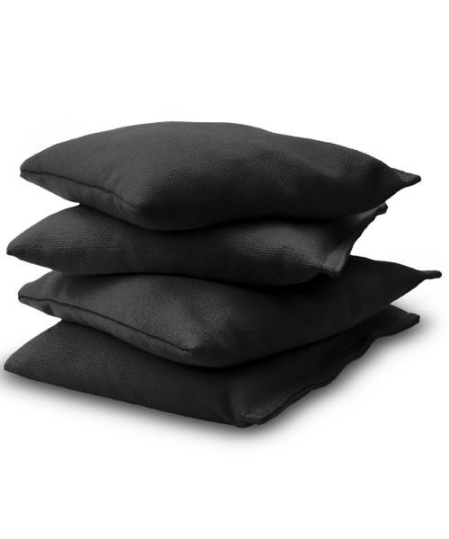Black Cornhole bags stacked