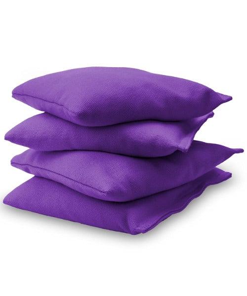 Purple Cornhole bags stacked