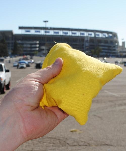 Yellow bag close up stadium behind
